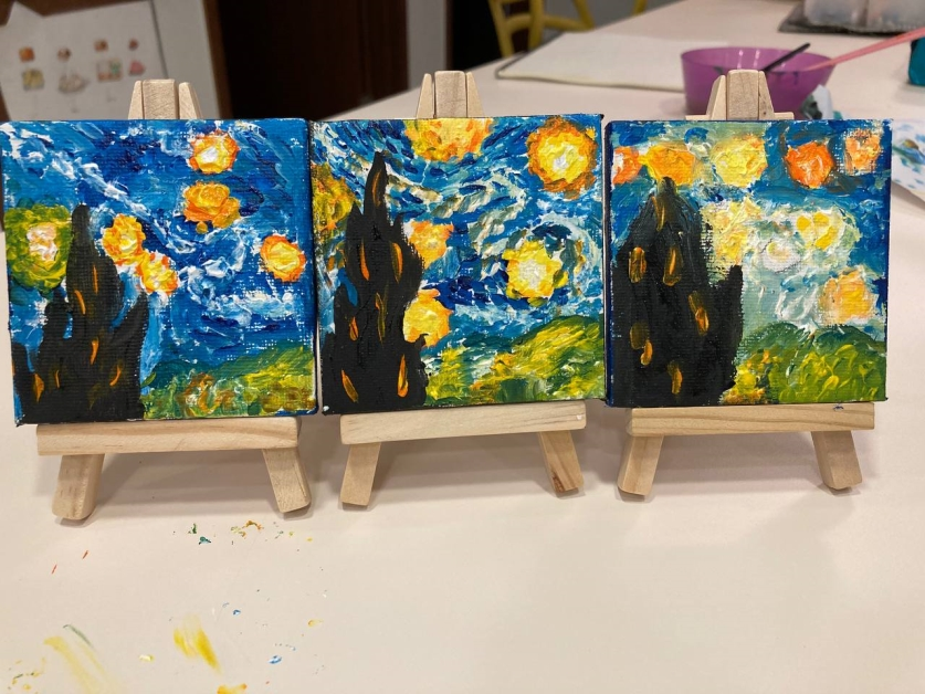 Artist Celine Chia's students - A rendition of Starry Night by Zoey (leftmost canvas, 8 years old) and Yara (rightmost canvas, 5 years old)